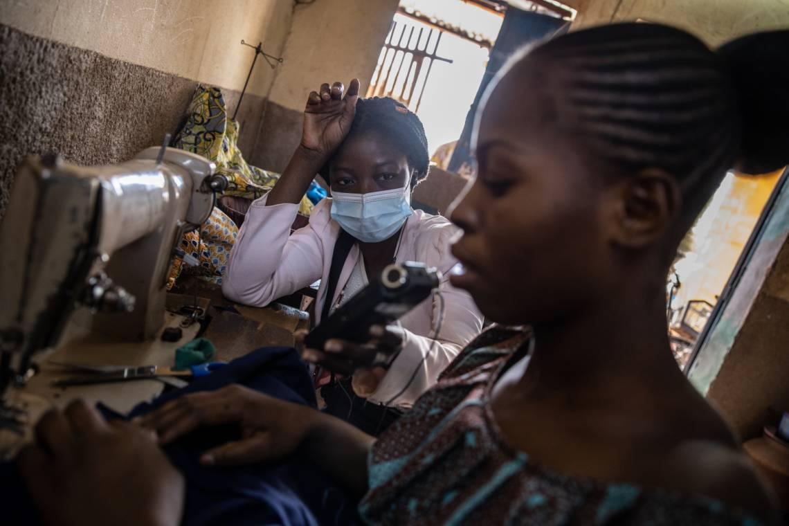 A Studio Yafa journalist interviews a trainee seamstress in Ouagadougou, Burkina Faso, January 2021.