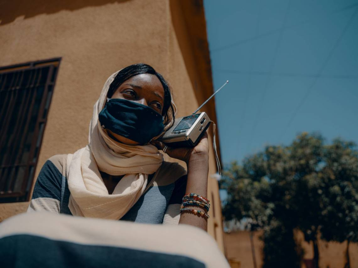 A woman listening to radio in Niamey, Niger, in April 2020.