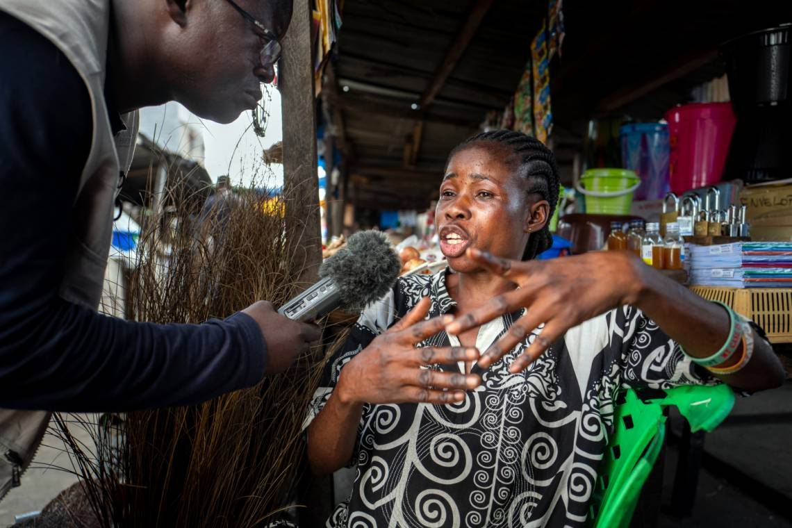 A journalist from Studio Hirondelle RDC reporting in Kinshasa, Democratic Republic of Congo.