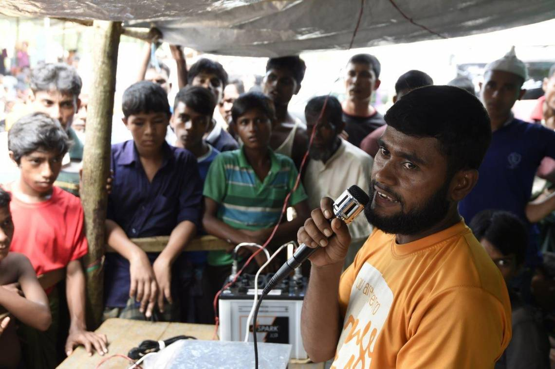 A Rohingya refugee broadcasts messages about people who got lost in Kutupalong camp in Bangladesh in September 2017.