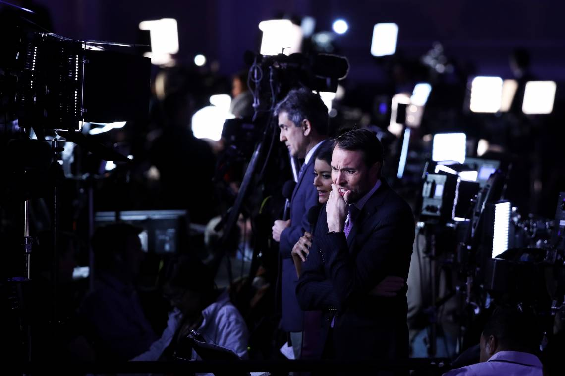 Broadcast media journalists stand ahead of Republican presidential nominee Donald Trump's election night event at the New York Hilton Midtown on November 8, 2016 in New York City.