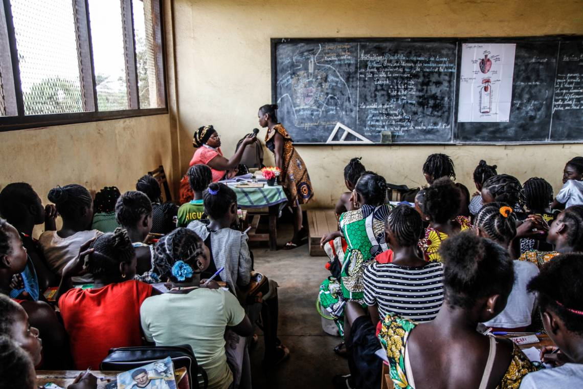 A Radio Ndeke Luka journalist reporting from a classroom in Bangui, Central African Republic.