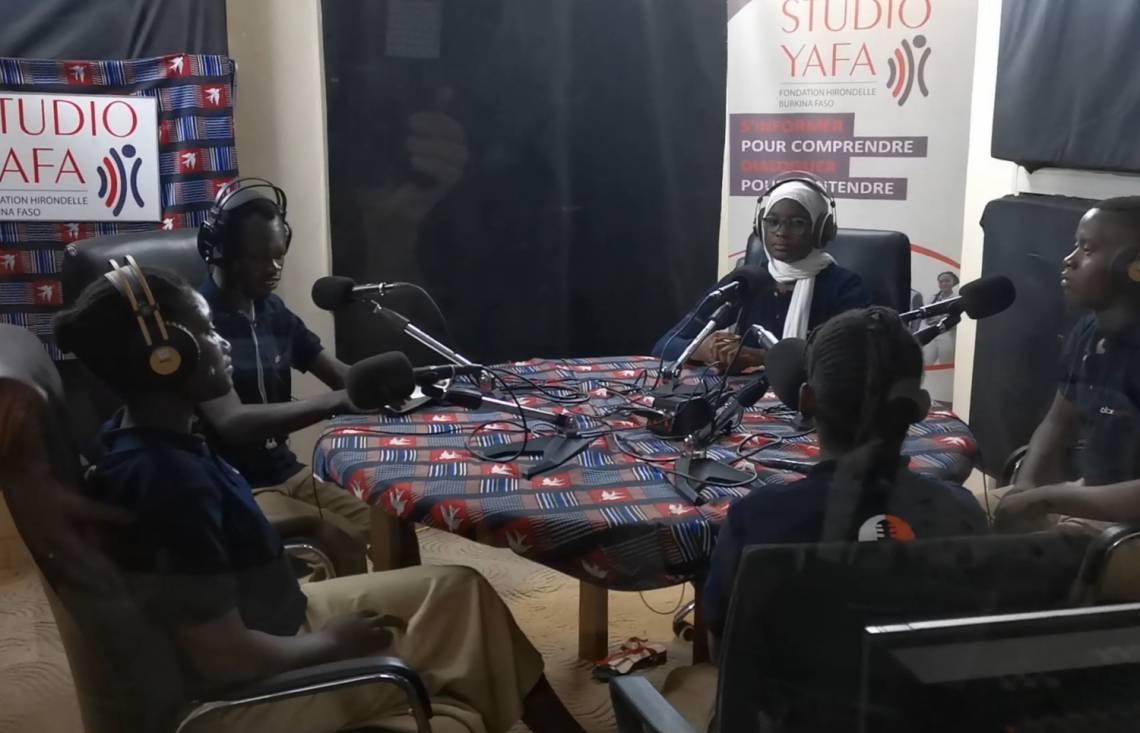 Radio debate exercise with young high school students in the main studio of Studio Yafa in Ouagadougou.