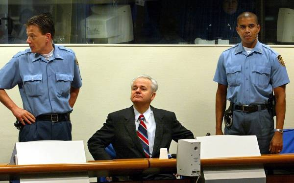 Former Serb President, Slobodan Milosevic facing the ICTY judges the 2nd day of his trial in 2002.