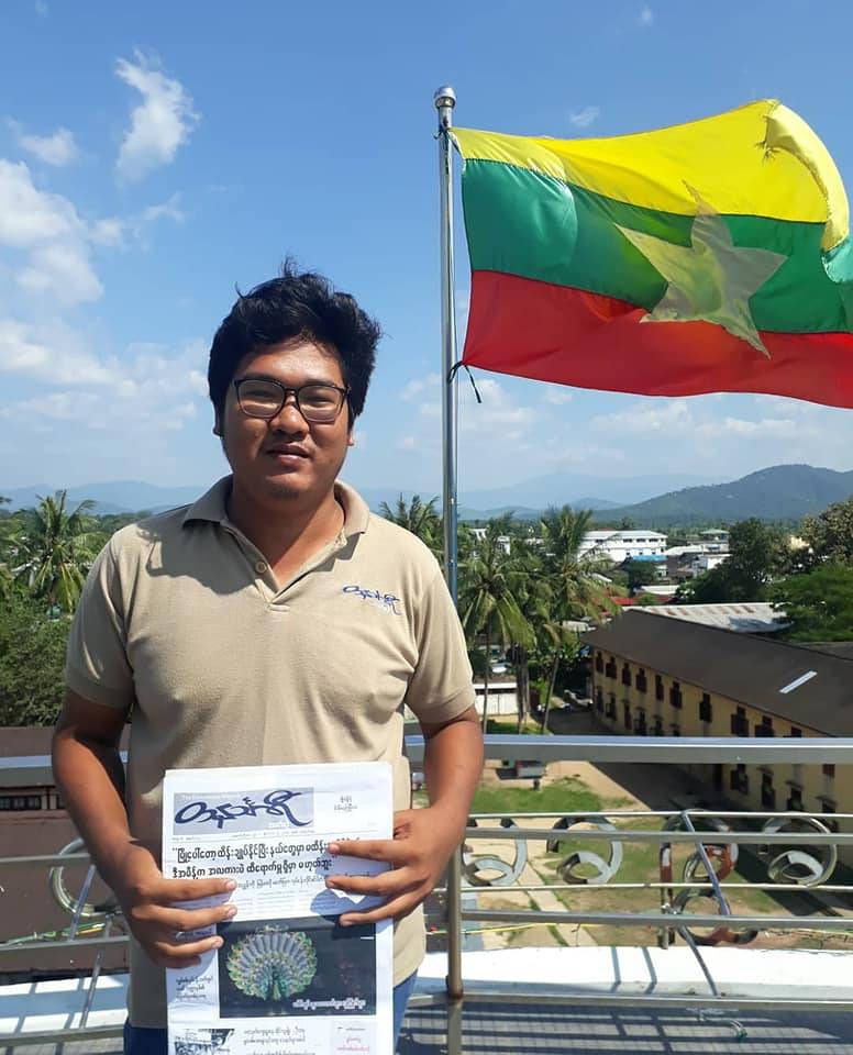 Ye Htut, 27, with a freshly-printed copy of The Tanintharyi Weekly, the journal that he edits.