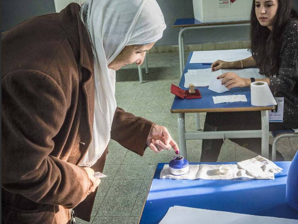 A woman votes in the 2014 presidential elections in Tunisia.